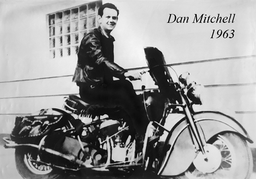 Dan Mitchell on motorcycle w-type layers